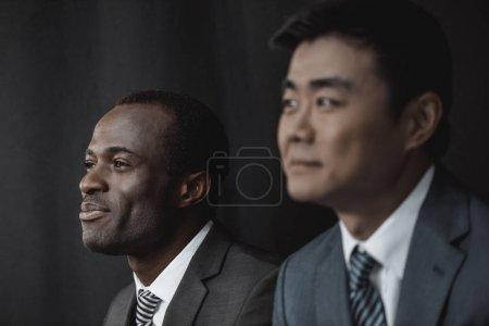 Photo for Selective focus of smiling african american businessman and asian colleague - Royalty Free Image