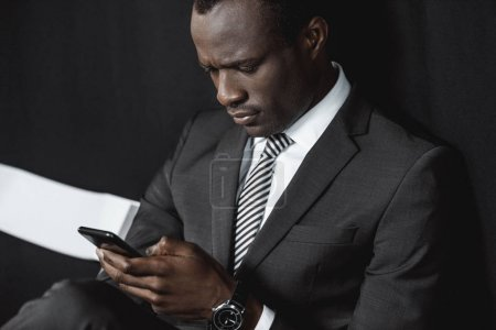african american businessman with smartphone