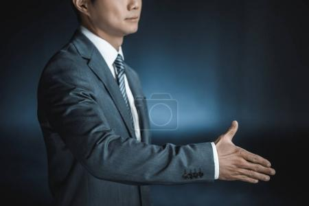 asian businessman outstretching hand