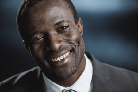 Photo for Portrait of smiling african american businessman looking at camera - Royalty Free Image