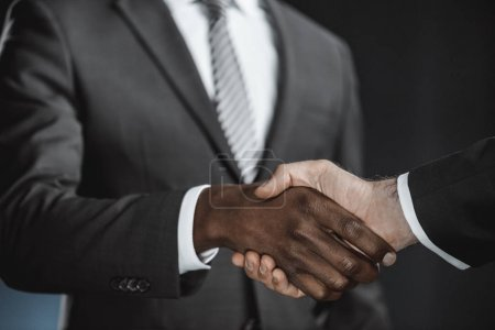 Photo for Selective focus of multicultural businessmen handshake - Royalty Free Image
