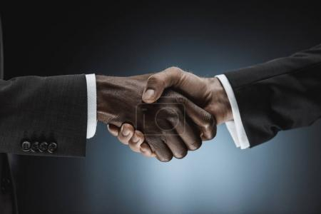 Multicultural businessmen handshake