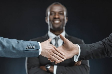 multiethnic business partners shaking hands
