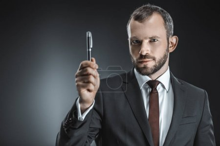 caucasian businessman with pen