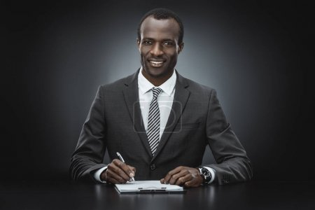 African american businessman doing paperwork