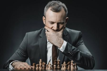 Pensive businessman and chess