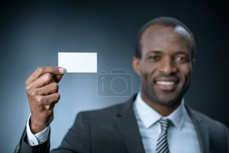 african american businessman with business card
