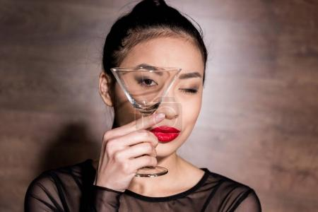 Asian woman with martini glass