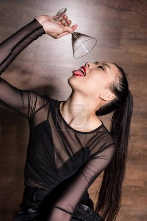 Photo for Portrait of young asian woman holding martini glass - Royalty Free Image