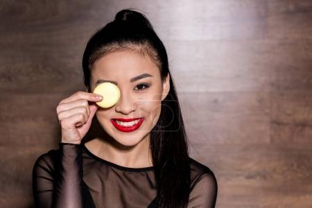 asian woman with macaron