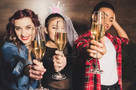 multicultural women with champagne at hen party