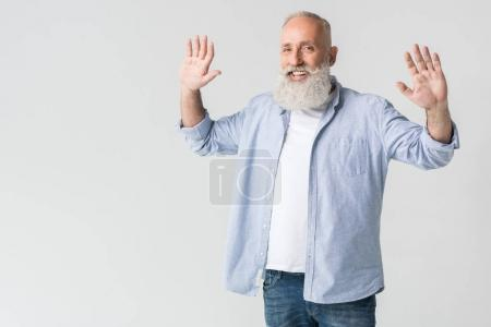 cheerful man with raised arms