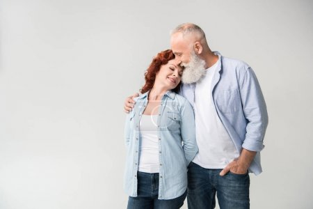 hugging mature couple