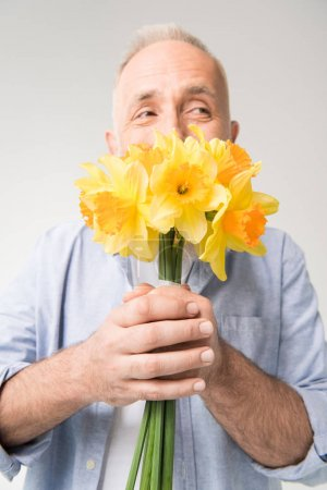 senior man with bouquet