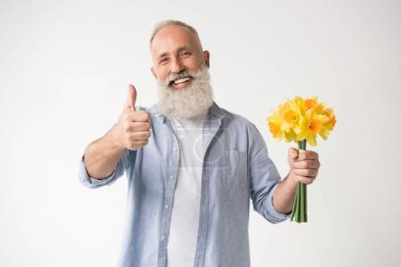 Man with flowers showing thumb up