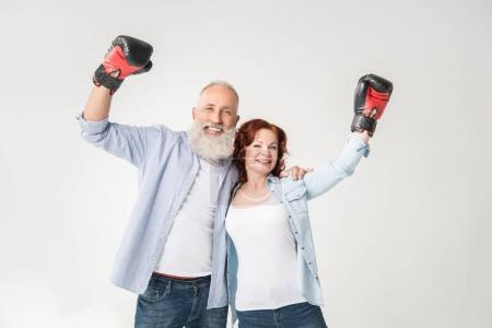 mature couple in boxing gloves