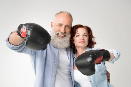 Photo for Smiling mature couple in boxing gloves, isolated on white - Royalty Free Image