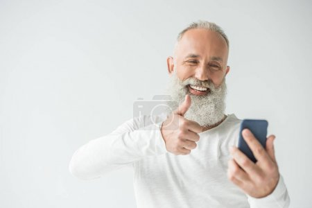 man taking selfie on smartphone