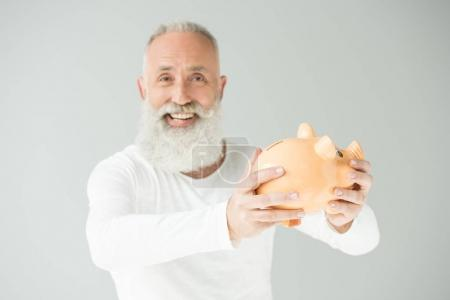 senior man with piggy bank