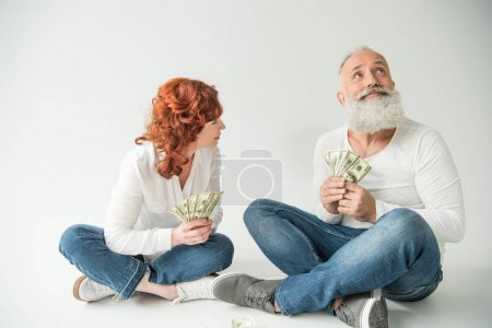 Dreaming couple with dollar banknotes