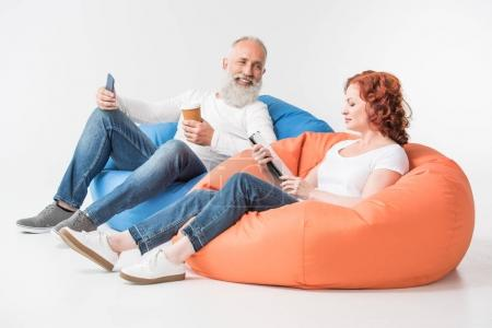 couple with coffee and gadgets