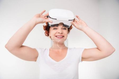 Photo for Happy mature woman using virtual reality headset, isolated on white - Royalty Free Image