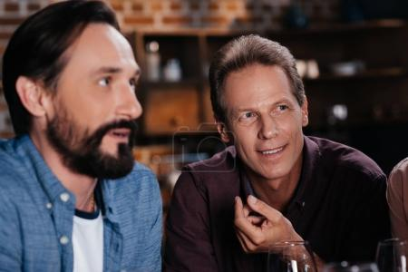 Photo for Close-up portrait of two handsome middle aged men looking away indoors - Royalty Free Image