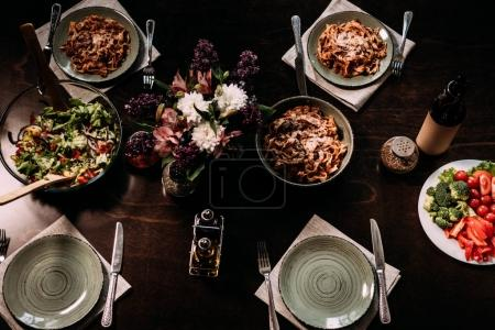 Photo for Top view of gourmet dishes and cutlery on table served for dinner - Royalty Free Image