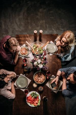 Photo for Overhead view of mature couples having dinner together - Royalty Free Image