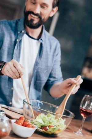 Man cooking salad