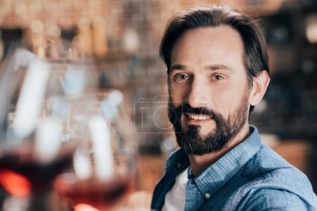 Photo for Close-up portrait of handsome bearded man smiling at camera - Royalty Free Image