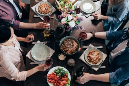 Photo for Cropped shot of middle aged friends having dinner together - Royalty Free Image