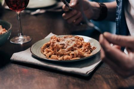 Photo for Cropped shot of person holding cutlery and eating tasty dinner - Royalty Free Image