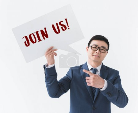 Asian businessman with card with sign Join us