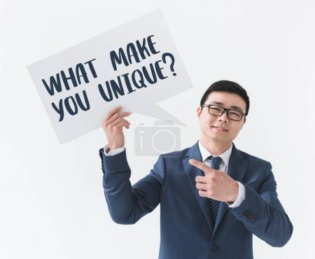 asian businessman with question on card
