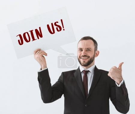 businessman showing join us card