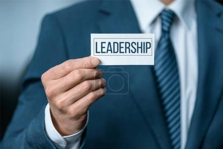 Business card with sign leadership