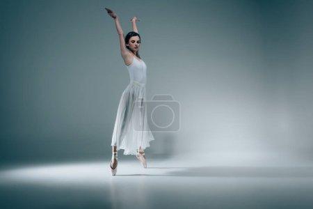Photo for Female ballet dancer in white dress - Royalty Free Image
