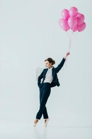 Photo for Businesswoman in suit and ballet shoes with pink balloons, isolated on grey - Royalty Free Image