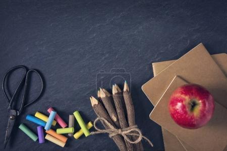 School supplies on a black