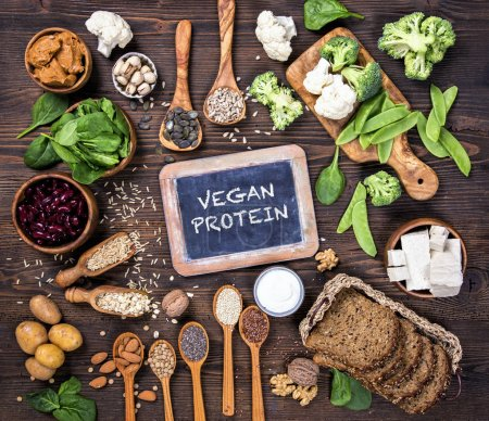 Photo for Vegan protein sources. Top view on a brown wooden background - Royalty Free Image