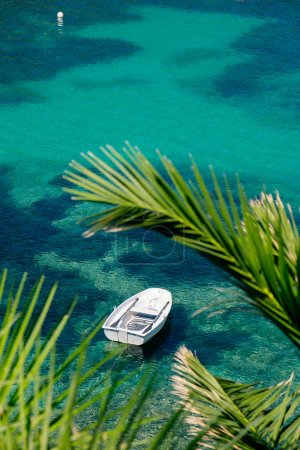 White fishing boat in beautiful lagoon.
