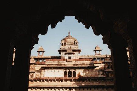 Jehangir Mahal (Orchha Fort) in Orchha, Madhya Pradesh, India. View through an arch