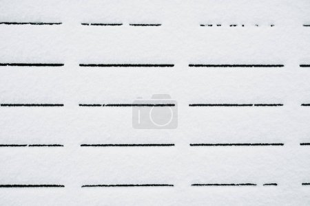 Black straight lines on snow. Snow texture minimalistic pattern. Background