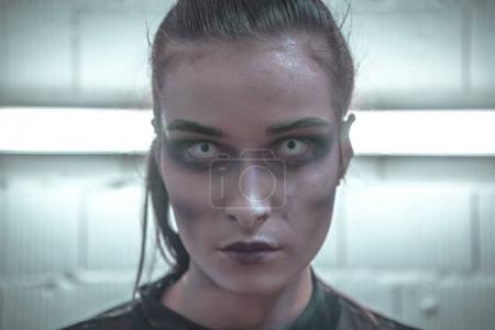 Makeup girl vapira. Portrait of a terrible girl. Vampire Makeup