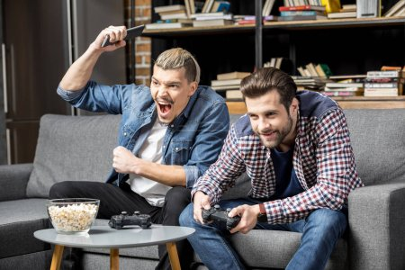 Men playing with joysticks