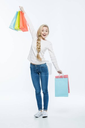 Photo for Full length portrait of happy young woman with shopping bags   isolated on white - Royalty Free Image