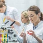Постер, плакат: Female scientists in lab