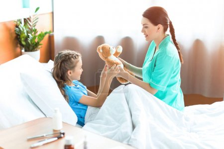 Girl and nurse in hospital