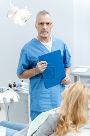 dentist with patient in dental clinic